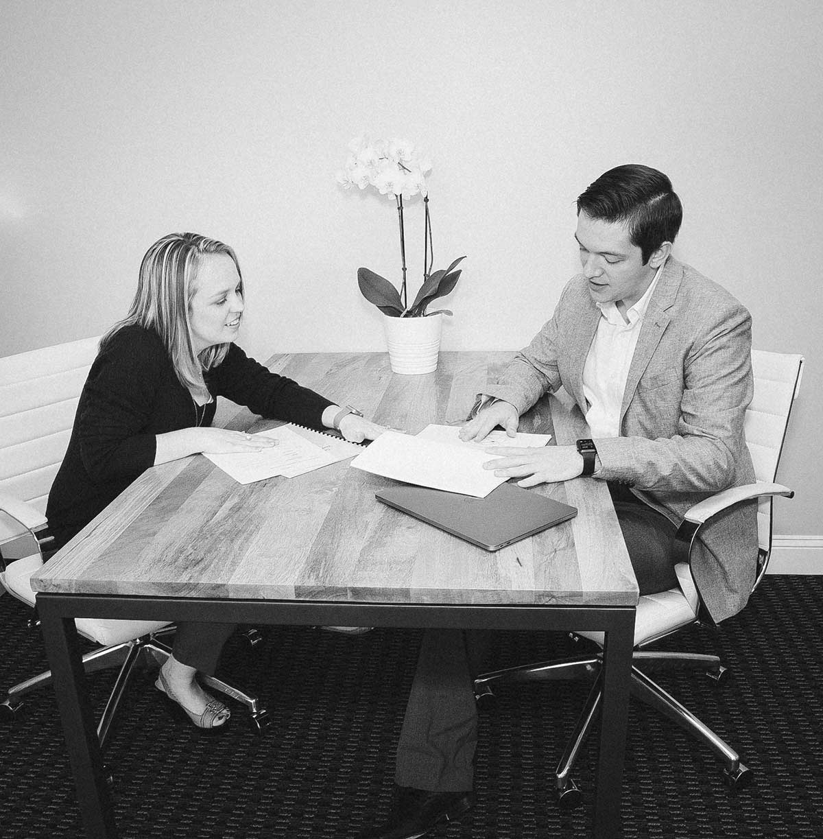 Kristen Hansen (left) and Cole Poppell (right) reviewing documents